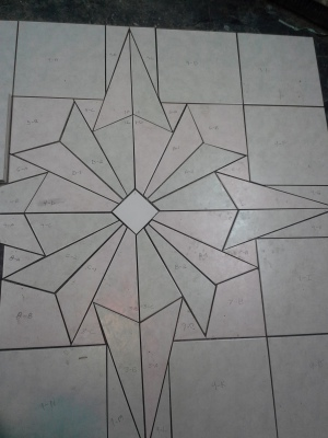 Custom Tile Mosaic laid out before installation