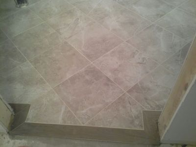 Tiled Bathroom Floor with Tile Border