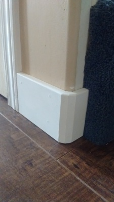 Baseboards and Laminate Floor installed