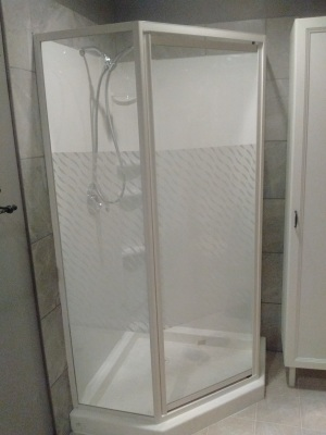 Installed Acrylic Shower and Tile along the sides